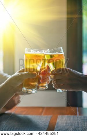 Glasses Filled With Beer Close-up. People Drink Beer. Happy Friends Drinking Beer And Clinking Glass
