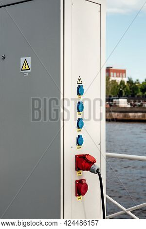 Locked Electric Panel With Attention Sign On Great Wall Of Transformer Substation. High Voltage Sign