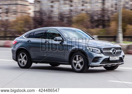 Moscow , Russia - April 2021: Front Side View Rolling Shot With Suv Car In Motion. Mercedes Glc Clas