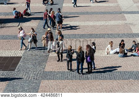 Madrid, Spain - April, 18 2021: People Enjoying Sitting Or Walking In Plaza Mayor Square In Central