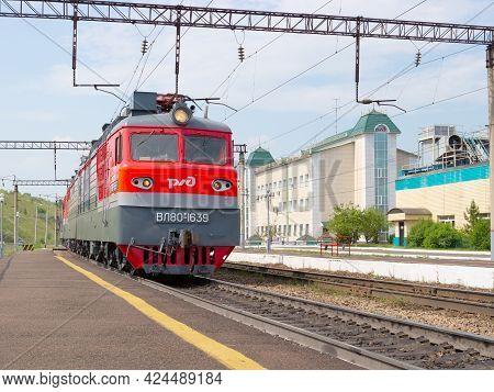 Krasnoyarsk, Russia - June 20, 2021: Red Commuter Passenger Train With Logo Russian Railways At The