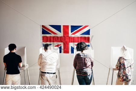 British people in a polling booth
