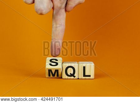 Sql Or Mql Symbol. Businessman Turns Cubes And Changes Words 'mql Marketing Qualified Lead' To 'sql