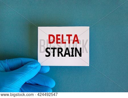 New Covid-19 Delta Variant Strain Symbol. Doctor Hand In Blue Glove With White Card. Concept Words '