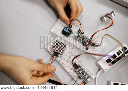 A Professional Engineer Assemble The Details Of Device With Pcb Controller And Counter With Numbers