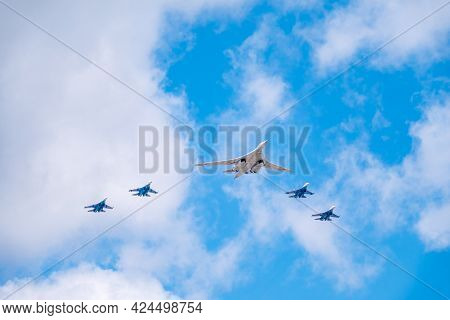 Moscow, Russia - May, 05, 2021: The Tu-160 Strategic Missile Carrier, Accompanied By Four Su-35s Fig