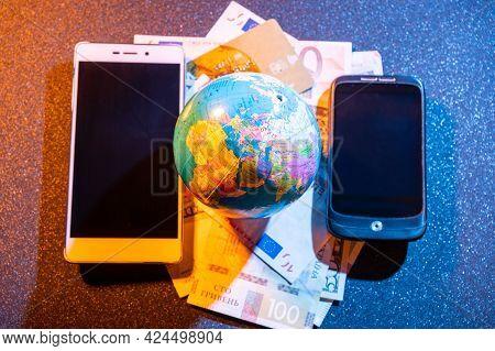 Fake Globe And Several Smartphones. Information Exchange. Global Finance Market. Communication All O