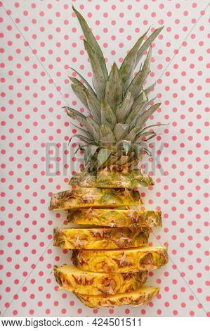Sliced Pineapple On Color Pink Summer Background. Tropical Fruit Sliced Pineapple Rings. Creative Fl