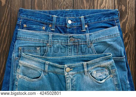 Blue Rubbed Jeans With Seams, Clasps, Buttons And Rivets, Texture, Close-up