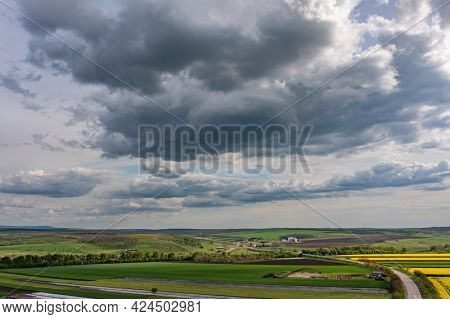 Aerial shot, overcast clouds above agricultural fields, copyspace
