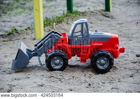 Children's Plastic Toy In The Sandbox Tractor