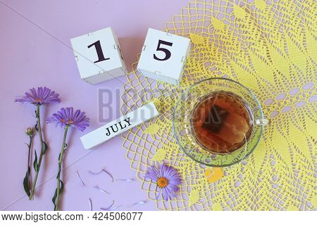 Calendar For July 15: Cubes With The Number 15, The Name Of The Month Of July In English , A Cup Of