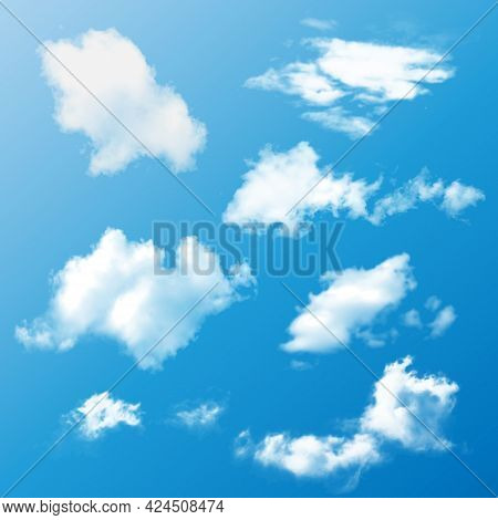 Realistic Set Of White Fluffy Summer Clouds On A Blue Background