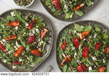Salad With Arugula Cheese Brie And Strawberry