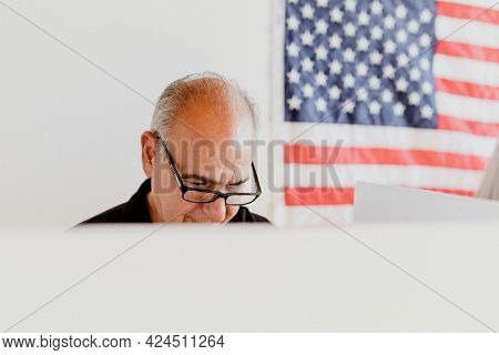Elderly American man at a polling booth
