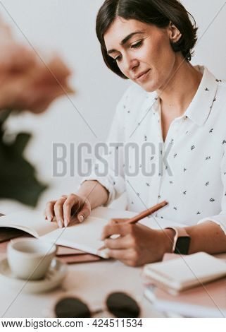 Young woman writing a journal