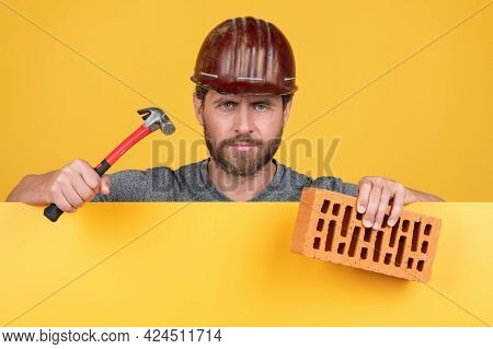Bricklayer. Mature Man In Helmet With Hammer And Brick. Builder Bearded Worker