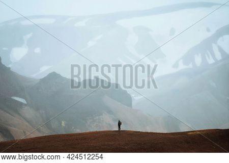 Man at Landmannalaugar in the Fjallabak Nature Reserve, the Highlands of Iceland