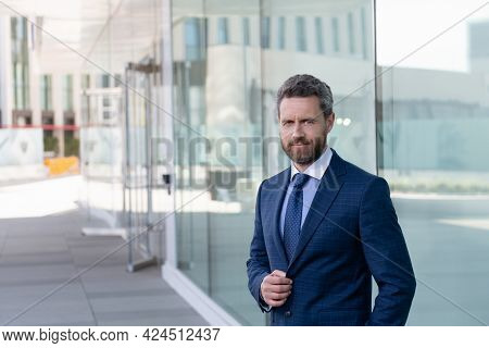 Successful Man Boss In Businesslike Suit. Manager Outside The Office. Male Formal Business Fashion.