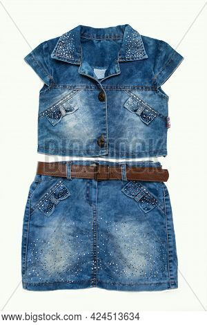 Jeans Jacket With Blue Jeans Skirt On White Background. Close Up. Front View.