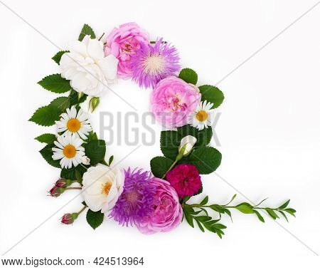 Letter Q, concept alphabet design. Floral summer font. Seasonal decorative beautiful type mades of different multi-colored blooming flowers and grass. Natural summertime print