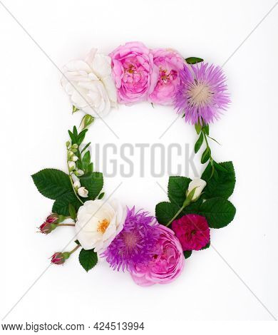 Letter O, concept alphabet design. Floral summer font. Seasonal decorative beautiful type mades of different multi-colored blooming flowers and grass. Natural summertime print