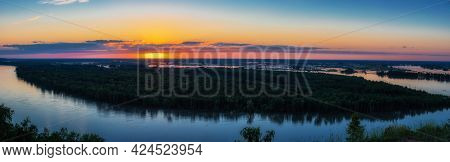 Big panoramic picture view of river landscape in sunny summer evening. View of siberian Ob river from in summer sunset.