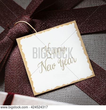 Happy new year tag on a present
