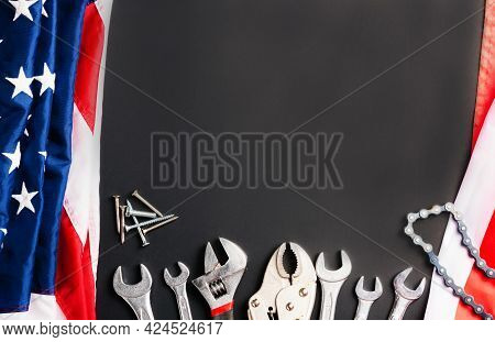 Labor Day Concept, Top View Flat Lay Of Different Kinds Wrenches With American Flag On Black. First