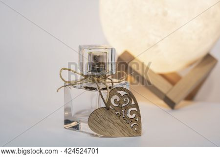 A Bottle Of Womens Eau De Toilette Or Perfume With A Heart, A Gift For A Beloved Woman
