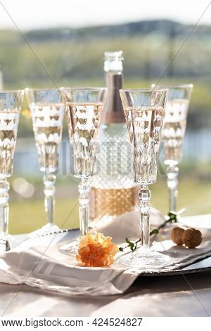 A Beautiful Wine Bottle Of Sparkling Rose Wine Along With Crystal Flute Glasses Filled With The Wine