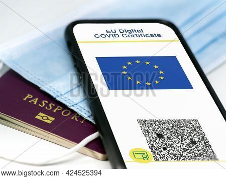 Eu Digital Covid Certificate With The Qr Code On The Screen Of A Mobile Phone Over A Surgical Mask A