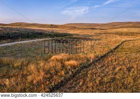 landscape of Nebraska Sandhills, early morning aerial view at Nebraska National Forest with dirt sandy road