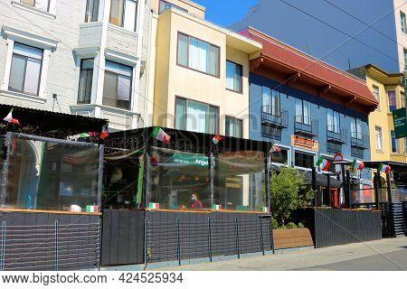 June 8, 2021 In San Francisco, Ca:  Vintage Victorian Buildings With Italian Restaurants Which Inclu