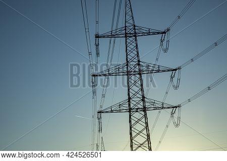 Crossing Electric Pylon In Beautiful Sunset Sky