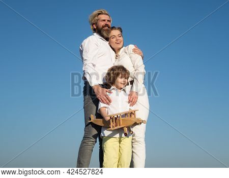 Family Day Outdoor. Boy With Young Parents. Motherhood Fatherhood. Son Dad Mother. Family With Child