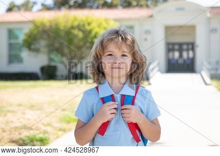 Little Boy On His First Day At American School. Beginning Of Lessons.