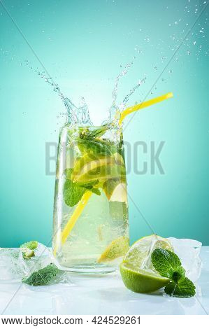 Refreshing Mojito With Ice. Bright Mojito With Mint. Refreshing Cool Drink. Beautiful Splash Over Th