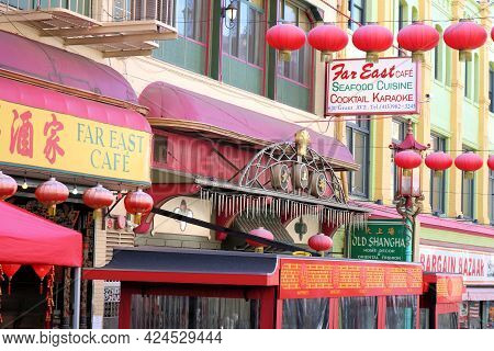 June 8, 2021 In San Francisco, Ca:  Chinese Stores And Restaurants With Decorative Lamps Over The St