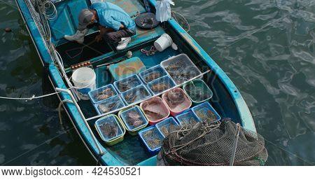 Sai Kung, Hong Kong, 22 September 2020: Sell seafood on fisherman boat