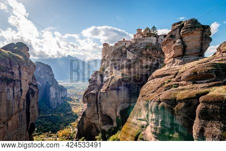 The Varlaam Monastery In Meteora, Greece. Scenic Landscape With The City Of Kalabaka In The Backgrou