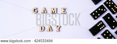 Text Game Day On White Background With Dominoes Dice. Table Game. Jomo. Board Games. Pastime. Domino