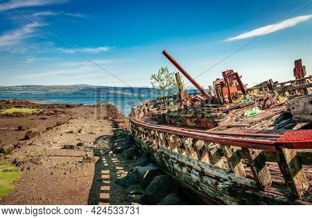 Fishing Boat Wrecks At Salen, On The Isle Of Mull. The Sound Of Mull Is In The Background.  Scotland