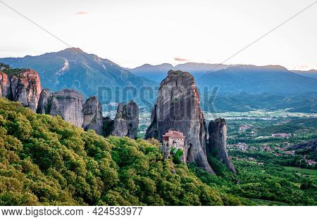 Rousanou Monastery In Meteora, Greece, With The City Of Kalabaka In The Background. Scenic Landscape