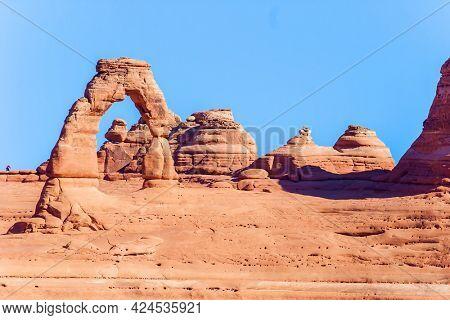 Delicate Arch. Picturesque red-brown sandstone cliffs form a unique landscape. Grandiose rock compositions natural origin. The beauty of Arches Park in USA.