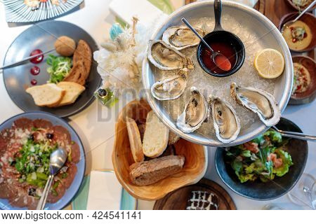 Seafood. Shellfish Mussels. Mussels With Lemon In Shells On Plate. Restaurant Serving Fresh Oysters