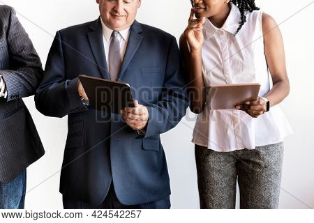 Group of businesspeople using digital devices