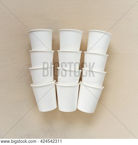 Disposable Beige Cups On Beige Background.cups Made Of Biodegradable Paper.tableware From Paper.plas