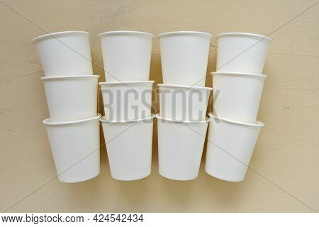 Cups Made Of Biodegradable Paper.tableware From Paper. Disposable Beige Cups On Beige Background.pla