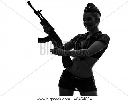 one caucasian sexy woman in army uniform holding kalachnikov in silhouette studio isolated on white background